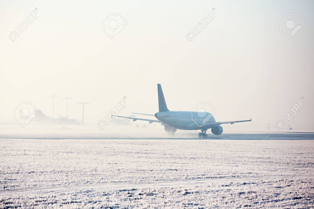 Airport in winter. Airplane is taking off in frosty day. - 69600231
