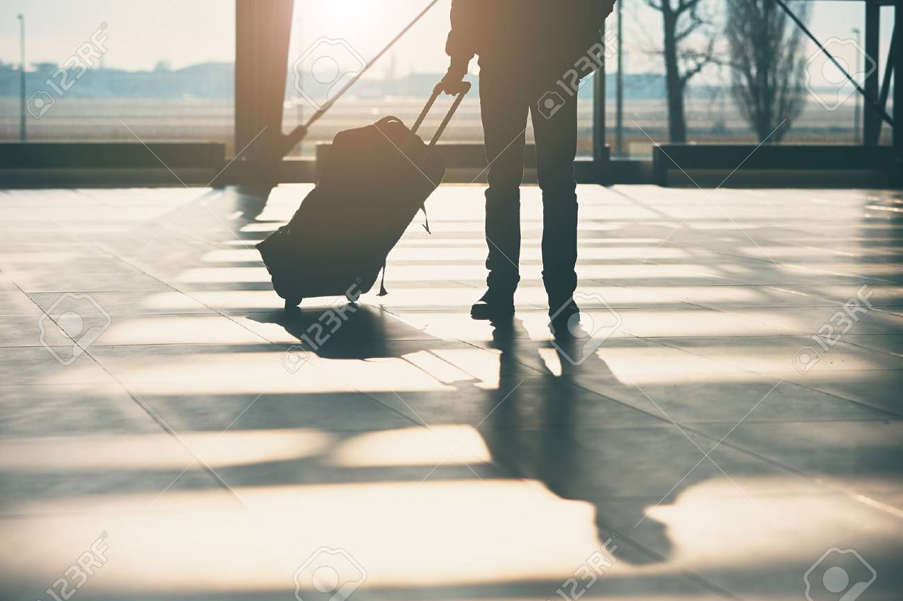 Shadow of the traveler with luggage at the airport. - 72632163