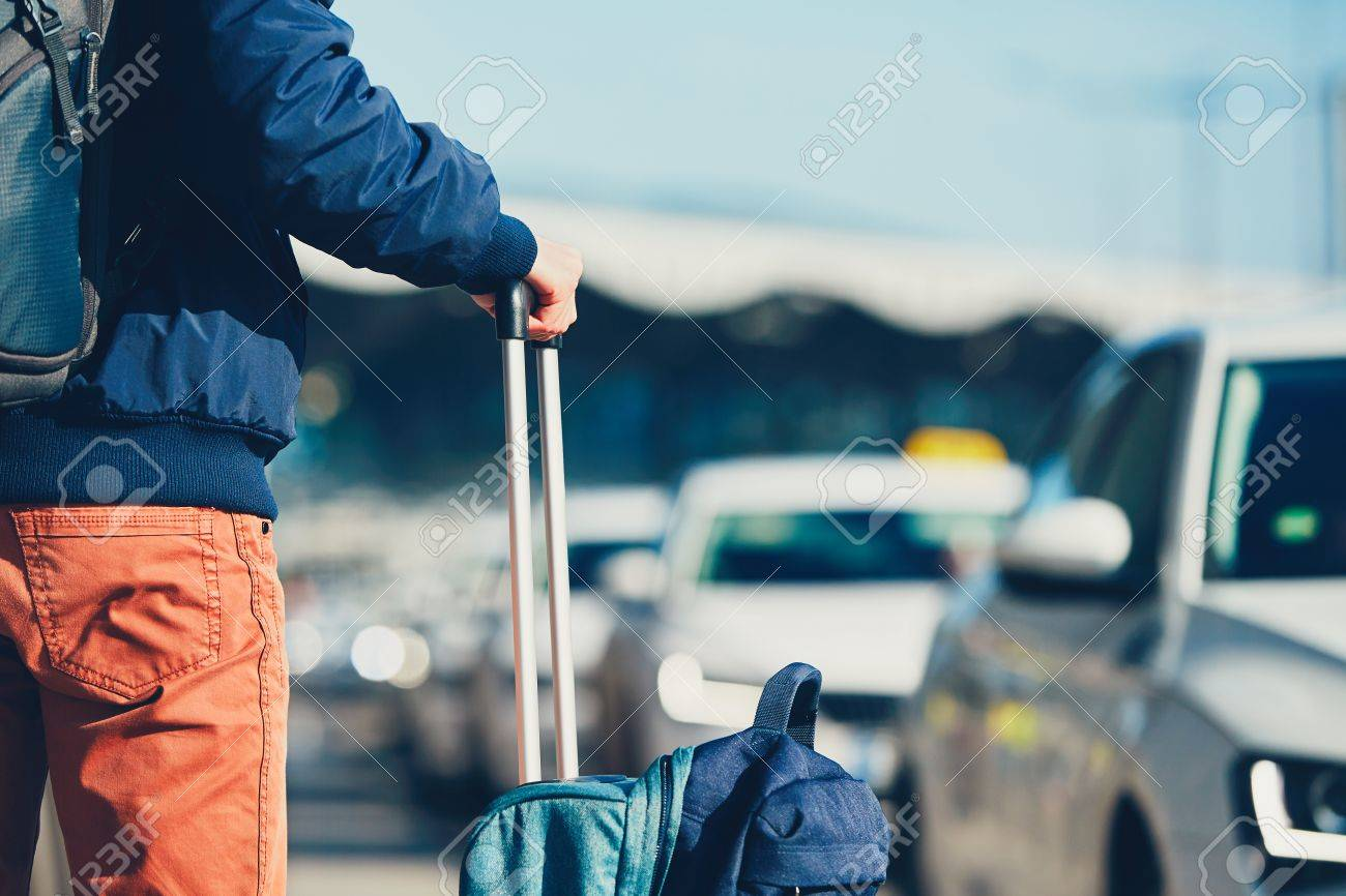 Airport taxi. Passenger is waiting for taxi car. Standard-Bild - 72630395