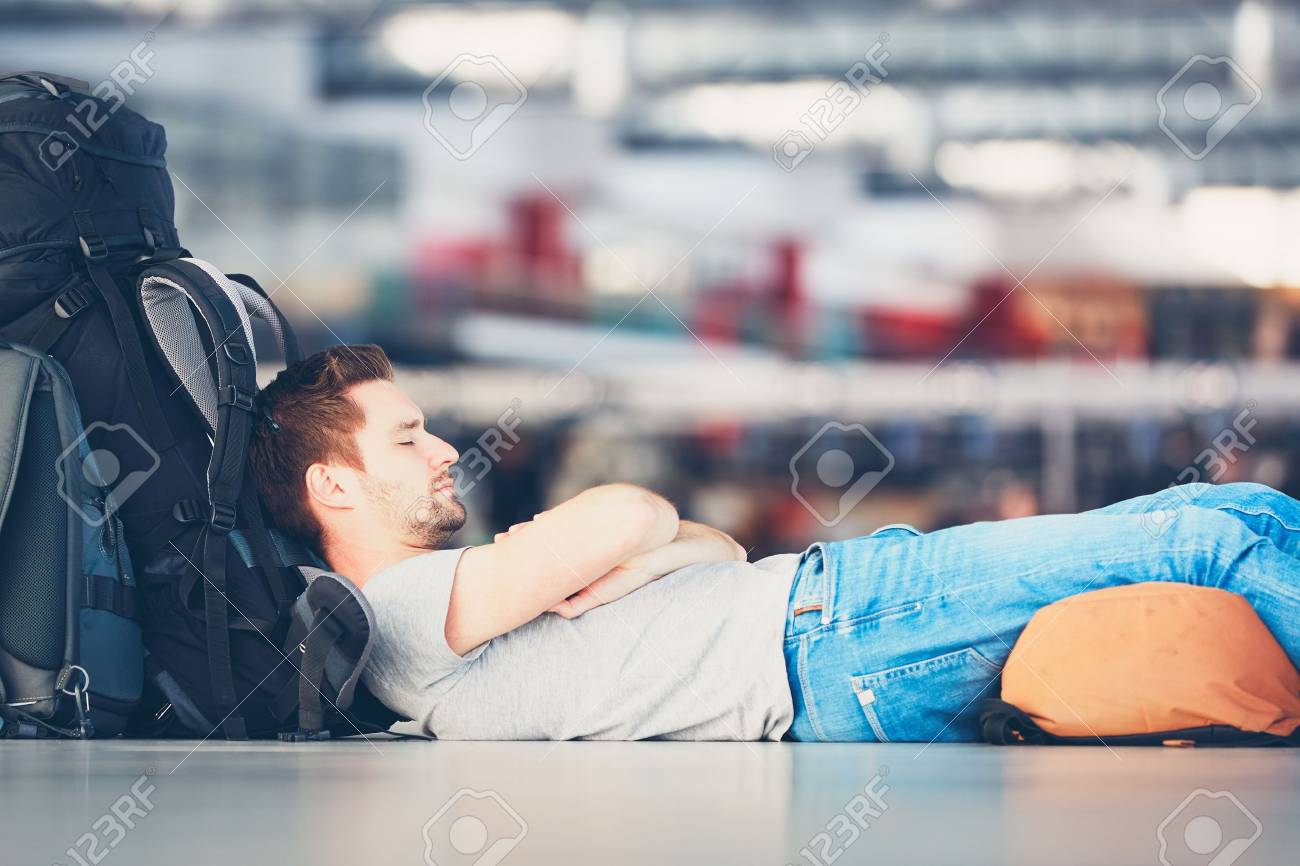 Traveler waiting at the airport departure area for his delay flight. - 72630393
