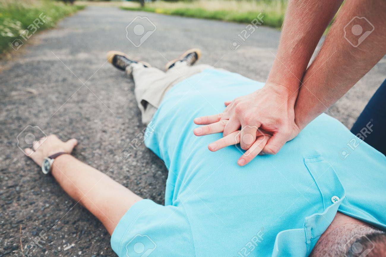 Dramatic resuscitation on the rural road. Themes rescue, help and hope. - 83277871