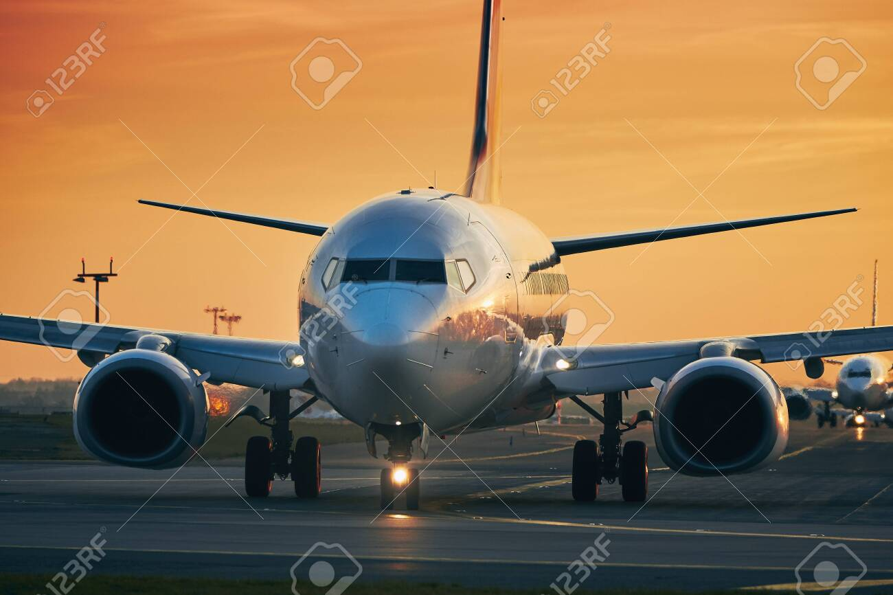Traffic at airport. Airplanes in row taxiing to runway for take off. - 144640337