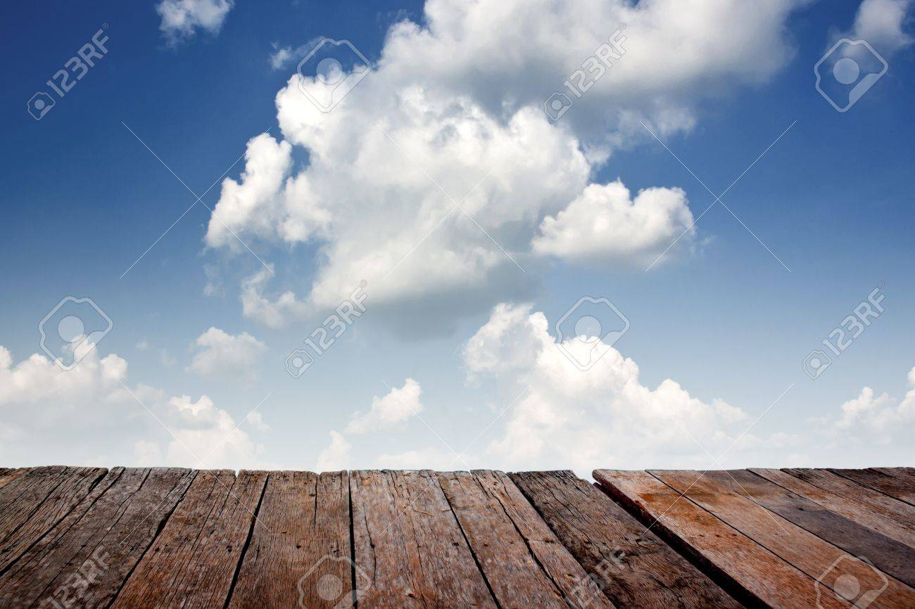 Texture of perspective Old wood floor and cloudy sky Stock Photo - 16404302