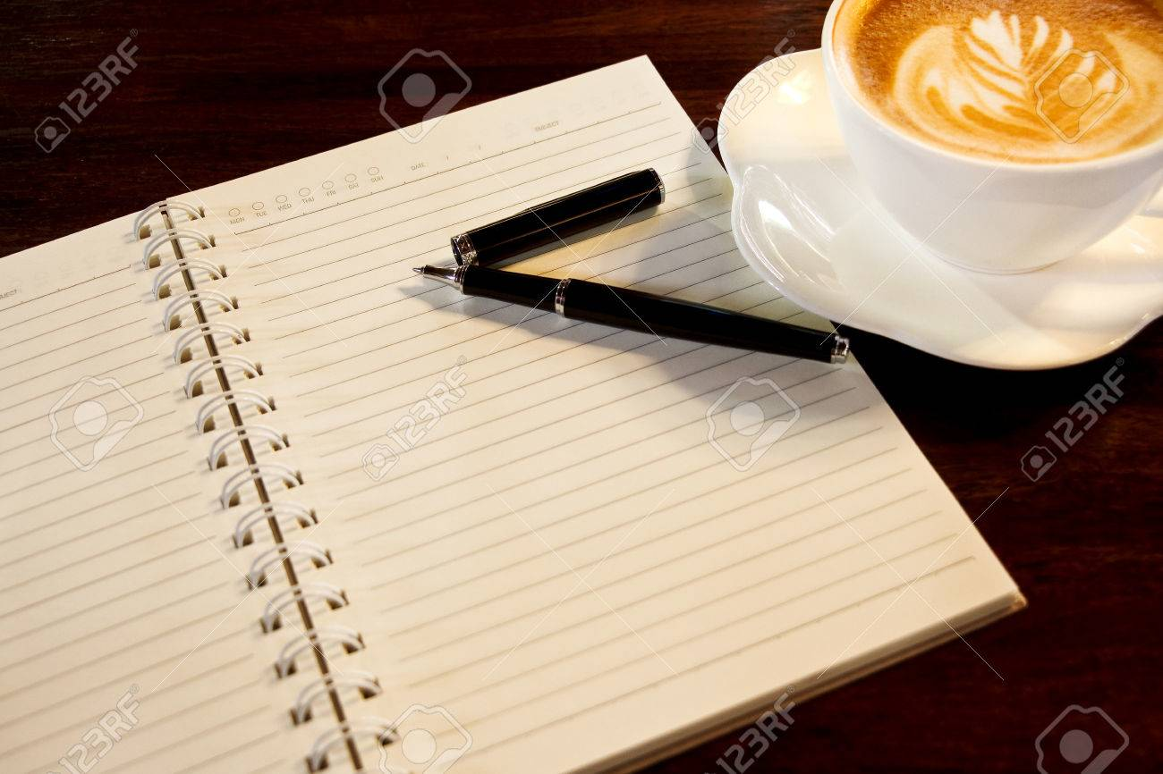 Coffee cup spiral notebook and pen on the wooden table background coffee cup spiral notebook and pen on the wooden table background stock photo 23151246 geotapseo Gallery