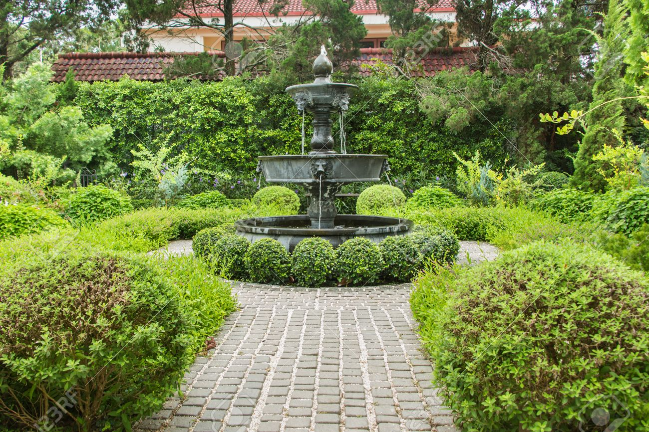 Fountain In English Garden Design. Stock Photo   45899401