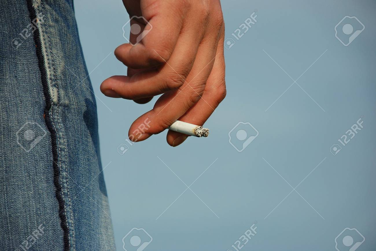 Hand with cigarette Stock Photo - 4531049