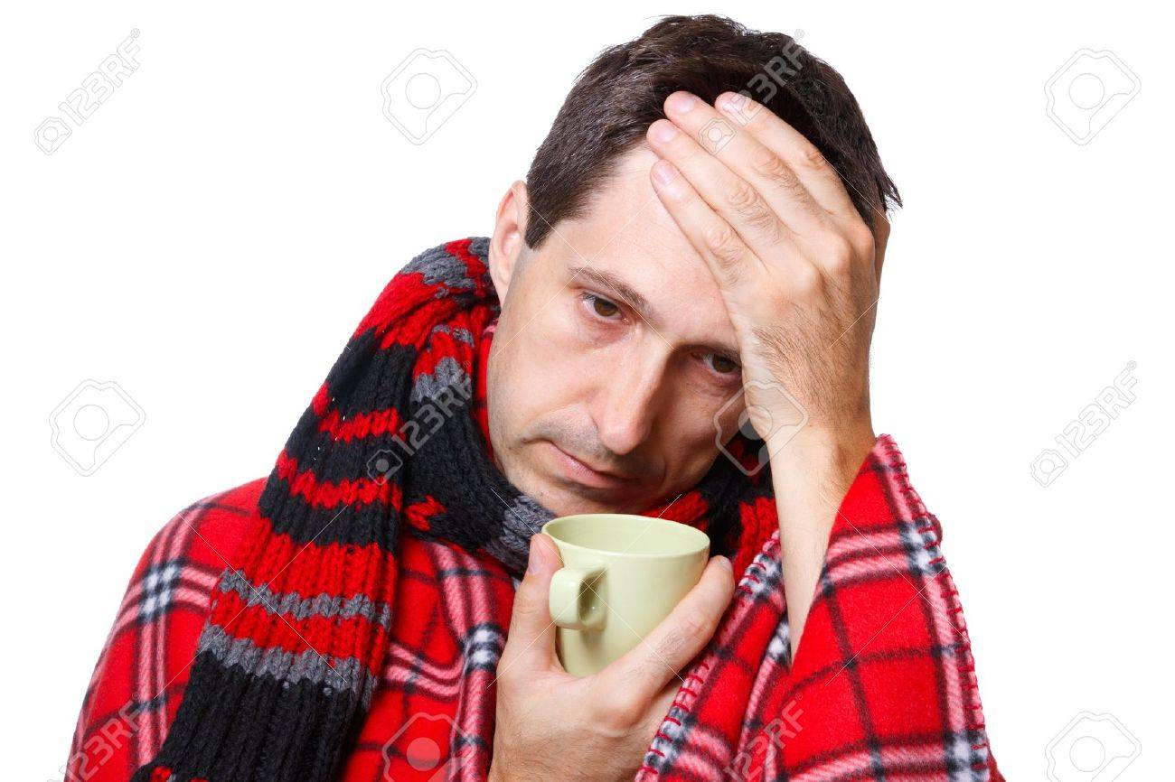 cold man with flu wrapped in a warm blanket, holding a mug Stock Photo - 12438018