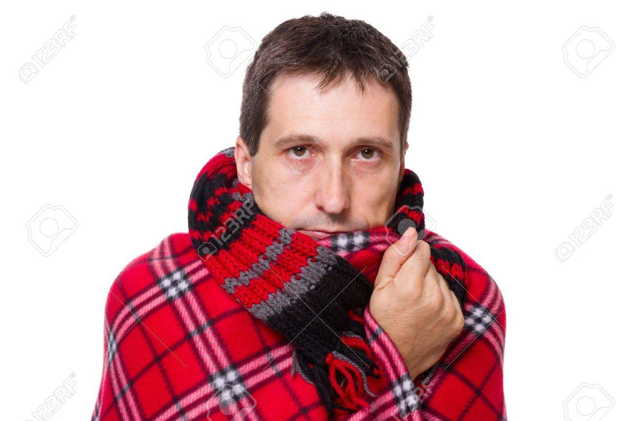 man wrapped in a warm blanket and scarf  shivering from the cold on white background Stock Photo - 12438010
