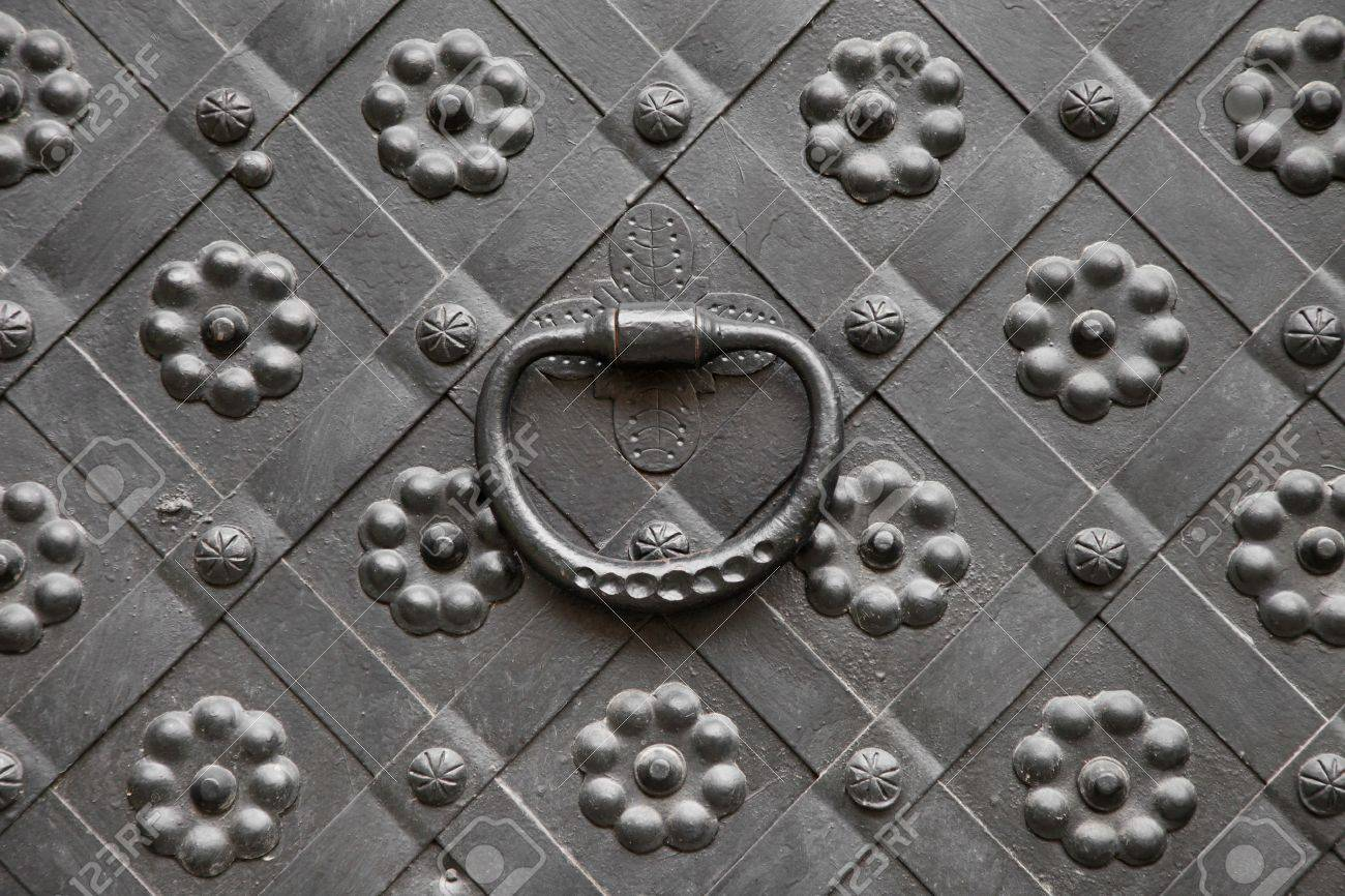 gate with door knocker, decorated with wrought iron Stock Photo - 21064845
