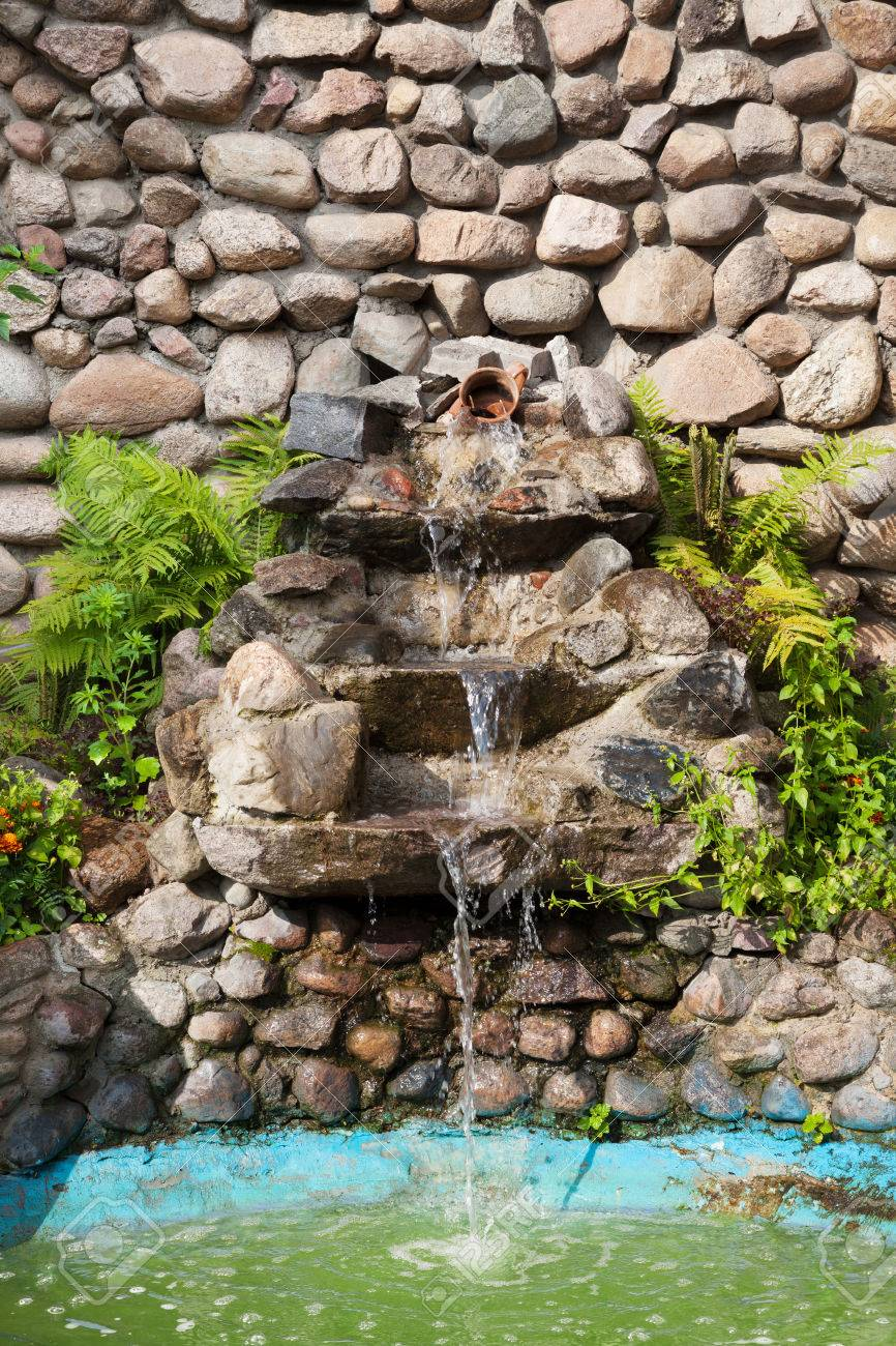 Decorative Garden Waterfall And Pond Made Of Stone Stock Photo   24089559