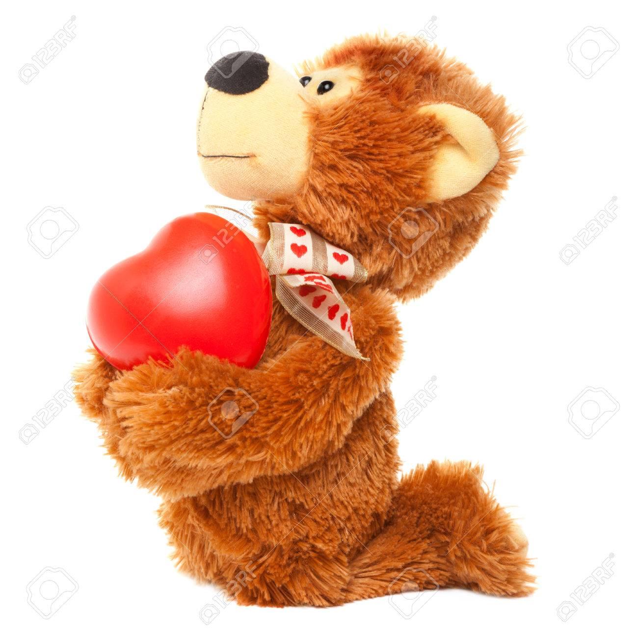 banque dimages ours en peluche se mettre genou et donnant le coeur - Ours Coeur