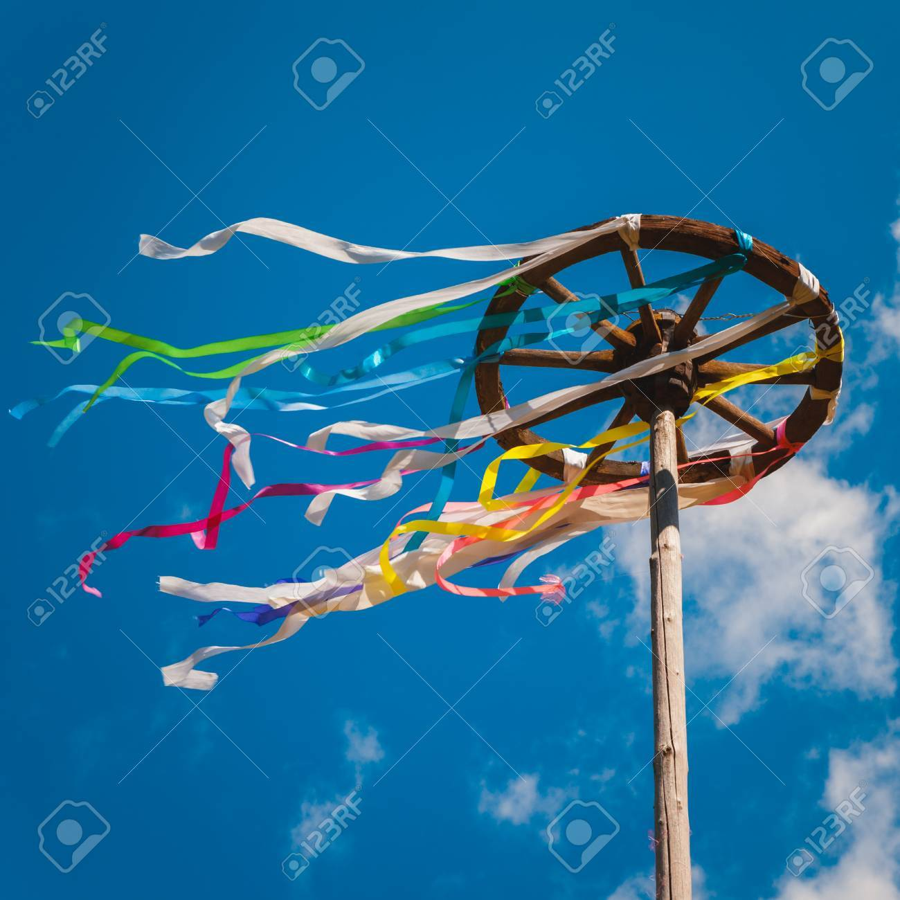 Wooden wheel with bright ribbons on blue sky background. Slavic celebration of Midsummer Stock Photo - 29839103