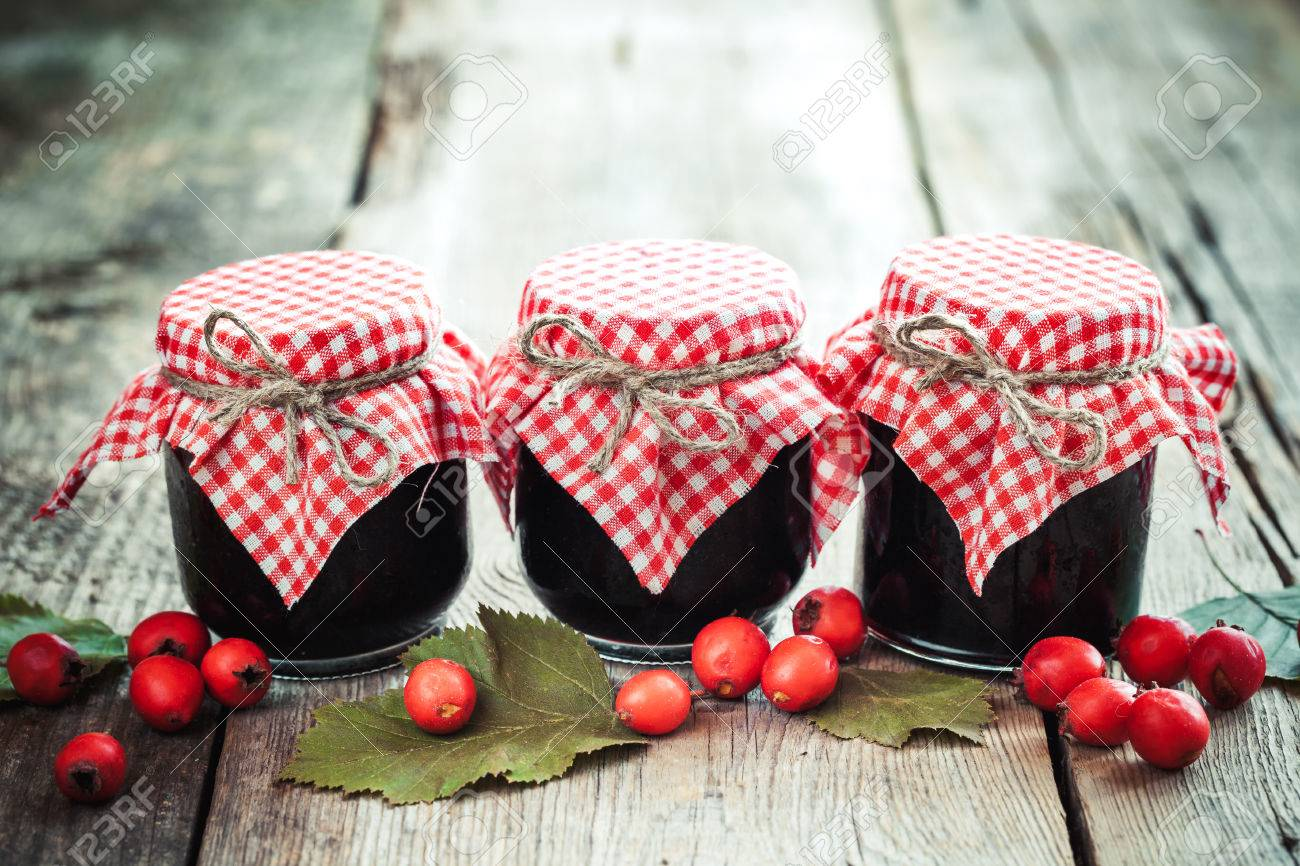 Three Jars Of Jam And Hawthorn Berries On Rustic Table Stock Photo ...