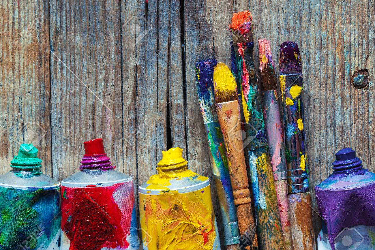 Tubes of oil paint and artist paint brushes closeup on wooden background. Retro styled. - 54790259