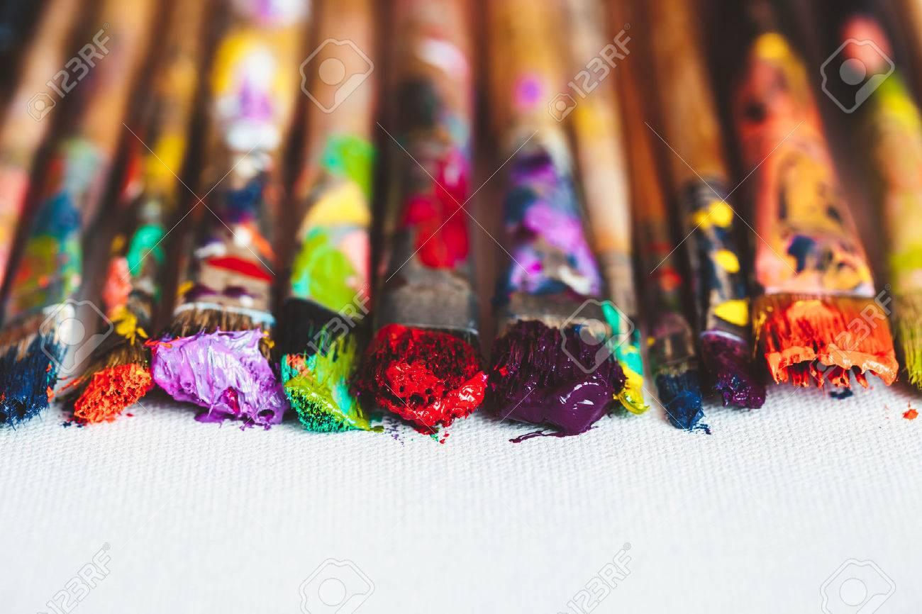 Artist paintbrushes closeup on artistic canvas. Selective focus. - 54790271