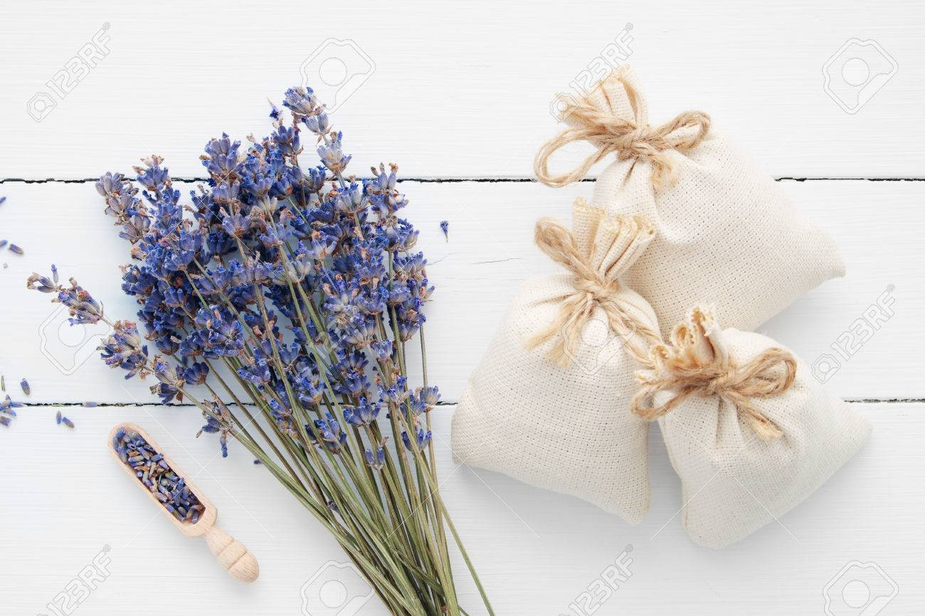 Bouquet of dry lavender flowers and sachets filled with dried