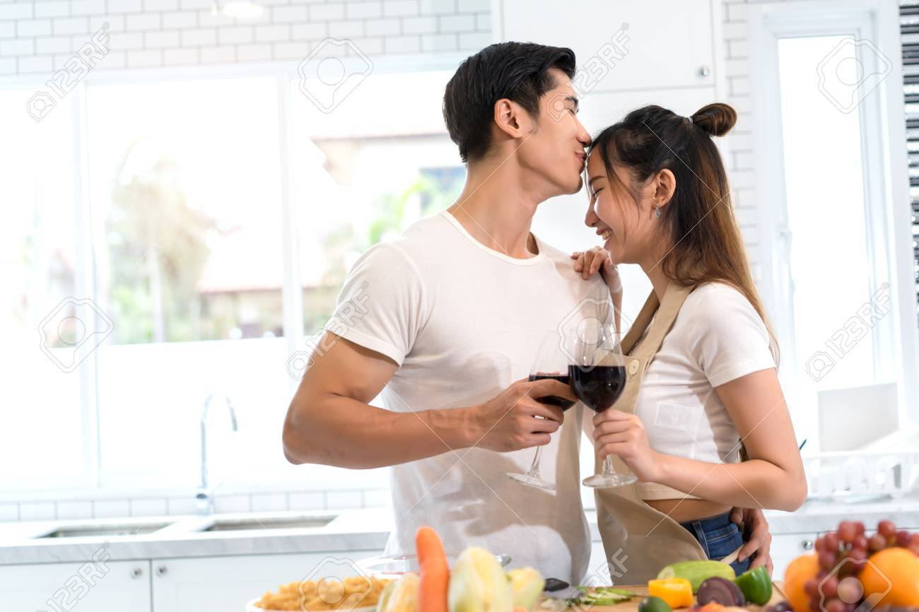 Young Asian Man And Woman Couple Together Holding Wine Glasses ...
