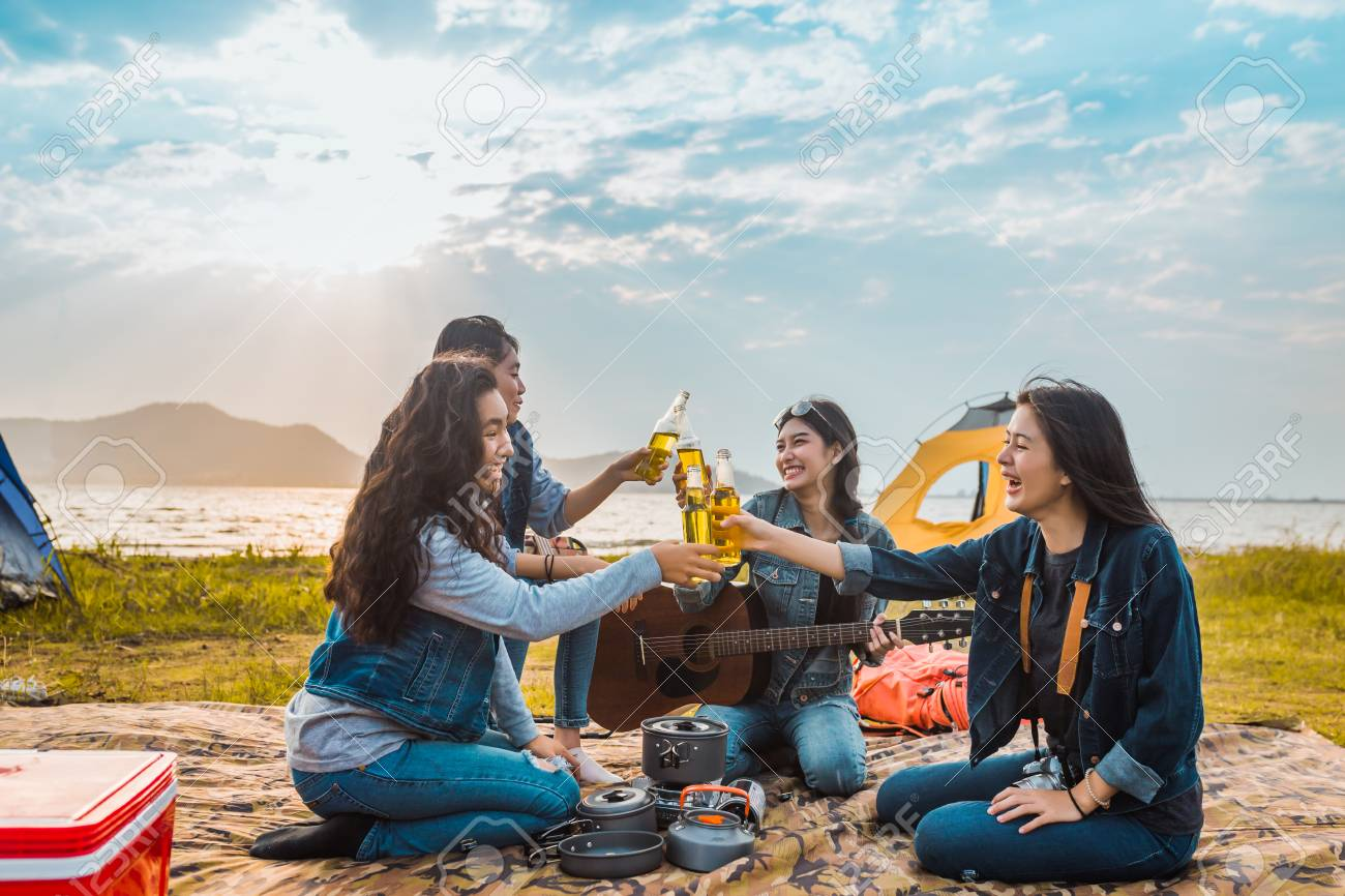 Diversity women party clink bottles enjoy camping,trekking,travel in vacation time relax. - 119665458