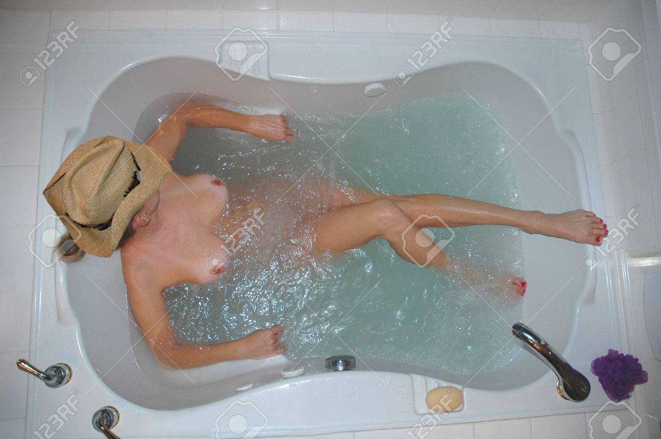 Woman Wearing A Cowboy Hat Relaxing In Spa Bath Tub. Stock Photo ...