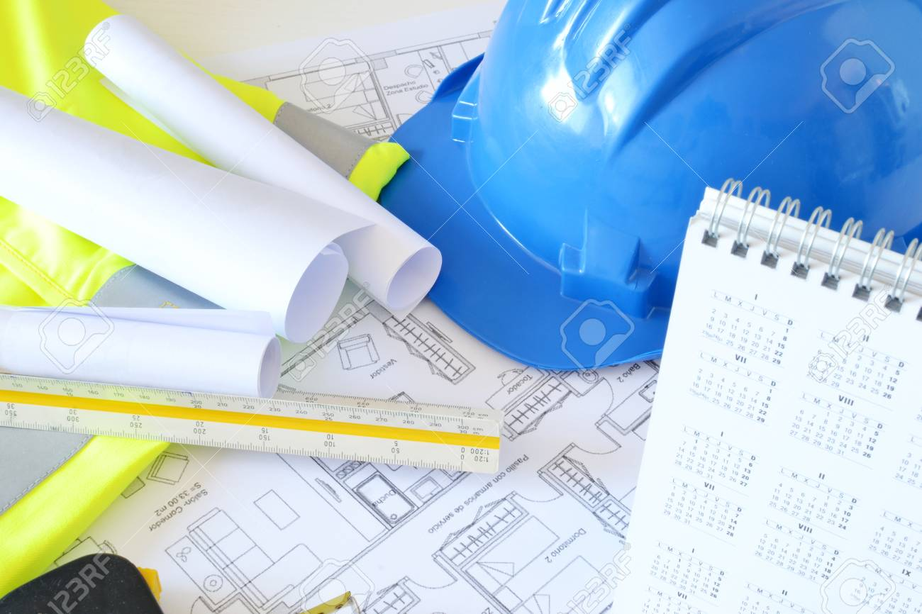 helmet and tools for construction drawings stock photo picture