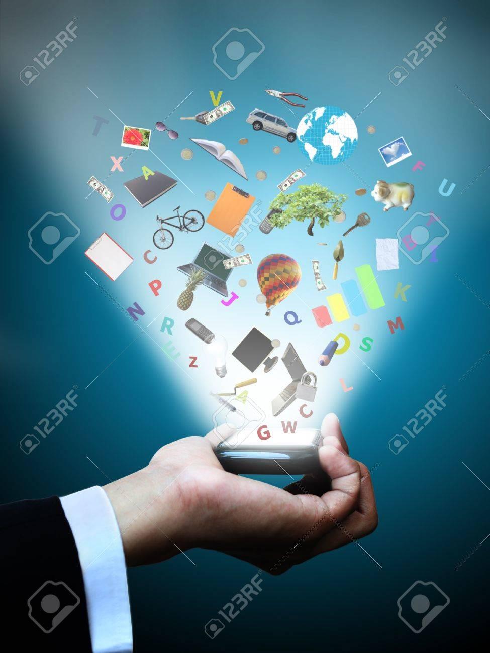 Hand holding magic phone Stock Photo - 12388379