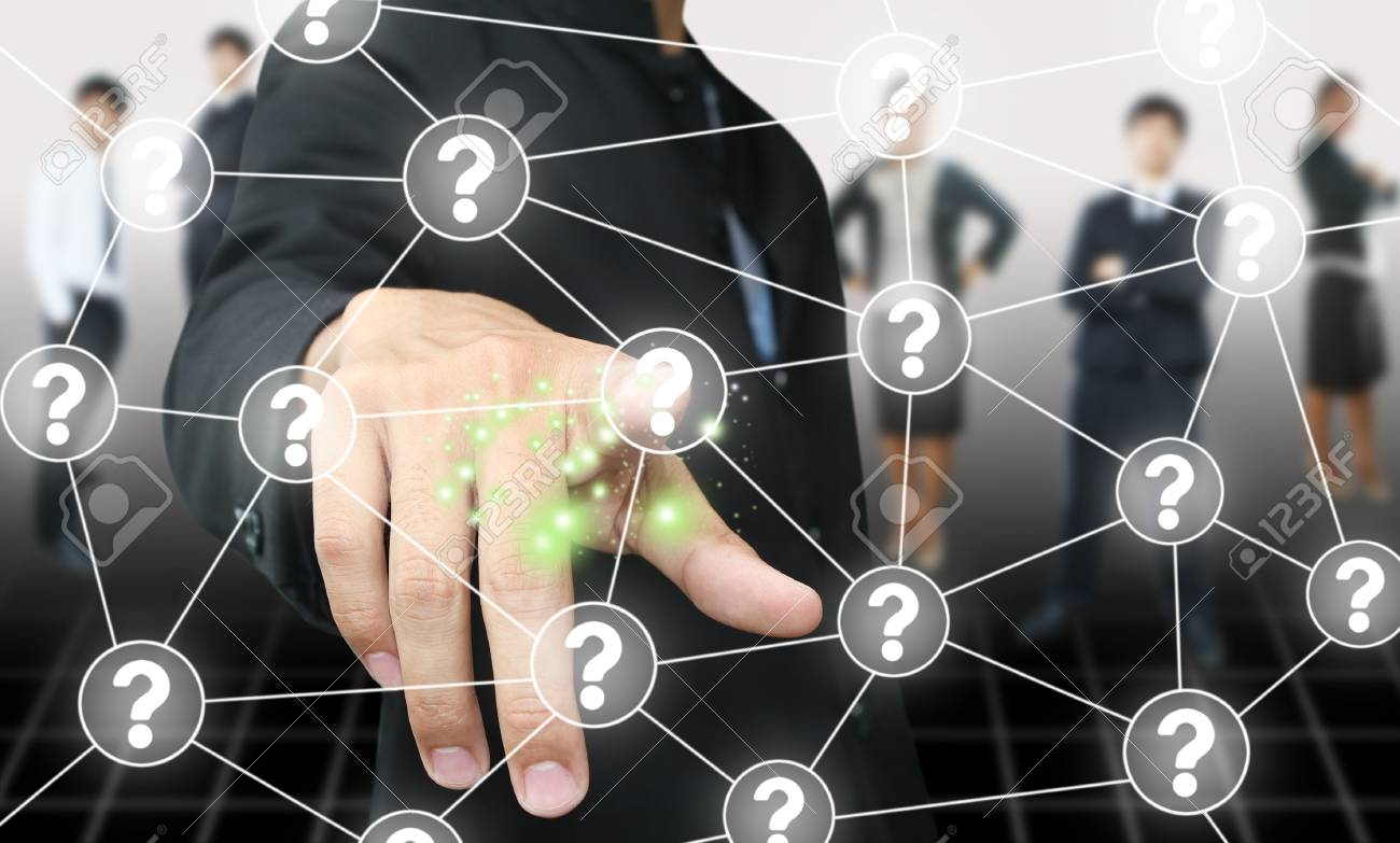 Businessman press question button Stock Photo - 15150236