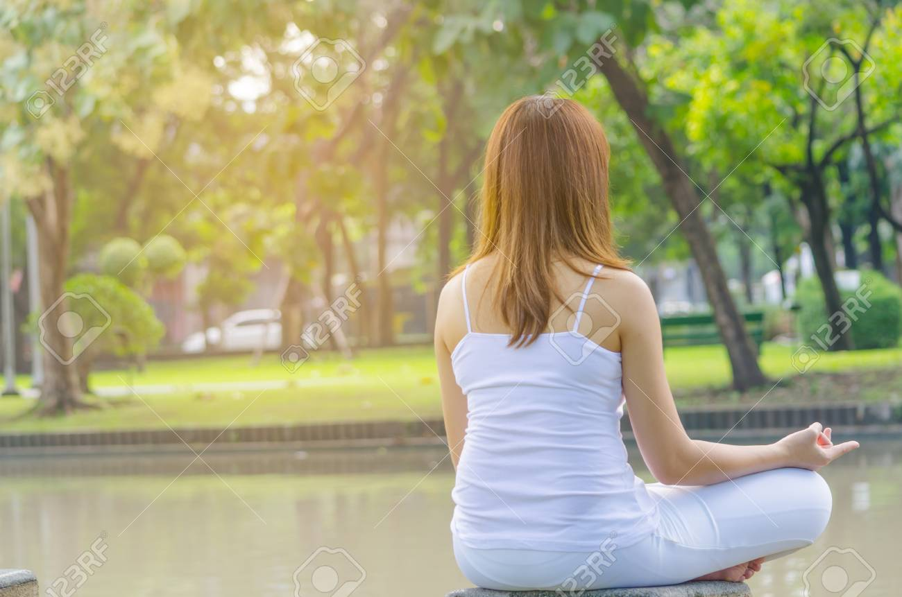 Beautiful Girl Practice Yoga Meditation At The Natural Park Copy Stock Photo Picture And Royalty Free Image Image 77881143
