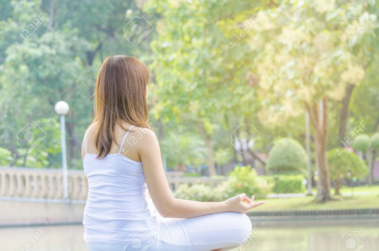 Beautiful Girl Practice Yoga Meditation At The Natural Park Copy Stock Photo Picture And Royalty Free Image Image 77907860