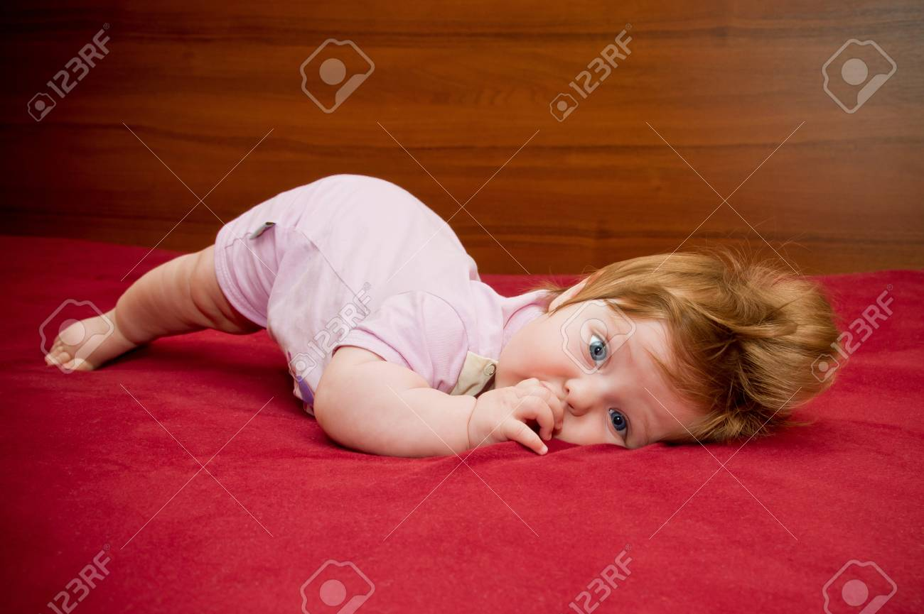 Cute funny touching baby girl with cheerful coiffure Stock Photo - 16305865