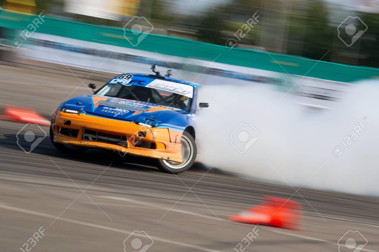 Odessa, Ukraine - August, 12, 2012. Ukrainian Drift Championship, 3rd stage, East European Drift Championship, 5th stage. Drift sport car in sharp sideslip. A lot of smoke Stock Photo - 16286923