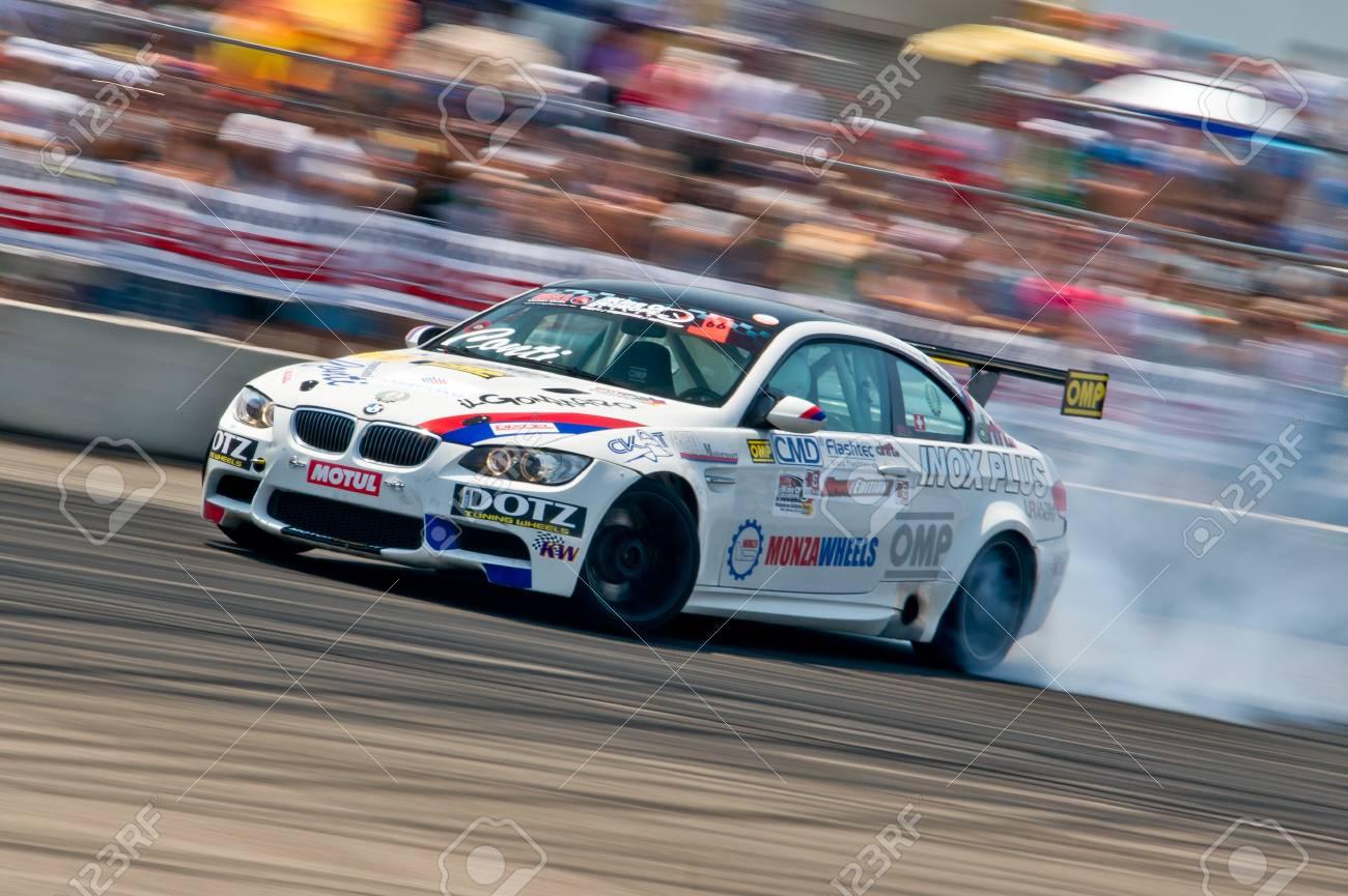 Odessa, Ukraine - July, 7-8, 2012. King of Europe, IV stage. Black Sea Drift Challenge. Drift sport car in sharp sideslip. A lot of smoke. Stock Photo - 16286931