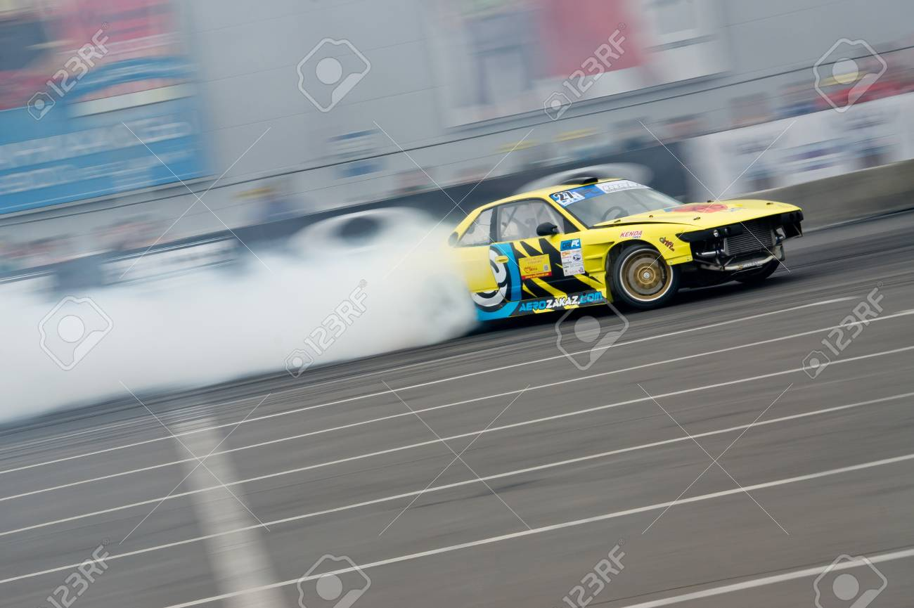 Odessa, Ukraine - August, 12, 2012. Ukrainian Drift Championship, 3rd stage, East European Drift Championship, 5th stage. Drift sport car in sharp sideslip. A lot of smoke Stock Photo - 16286949