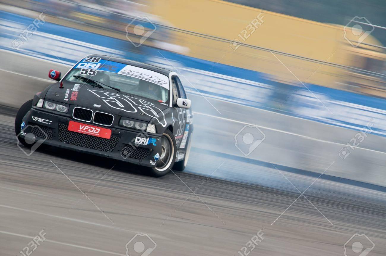 Odessa, Ukraine - August, 12, 2012. Ukrainian Drift Championship, 3rd stage, East European Drift Championship, 5th stage. Drift sport car in sharp sideslip. A lot of smoke Stock Photo - 16286947