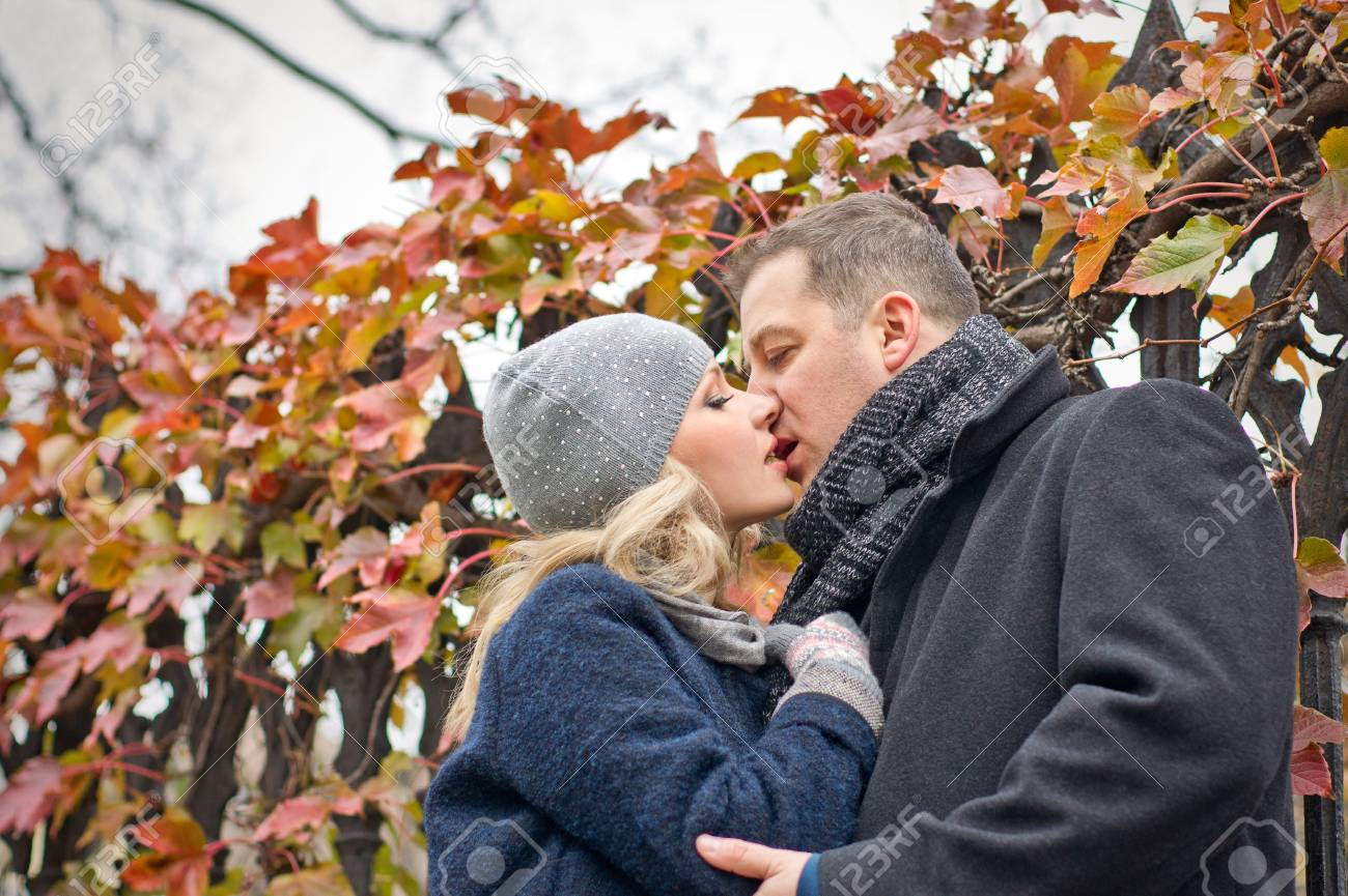 Date  Young woman and man tender kisses outdoor  Autumn Stock Photo - 16932714
