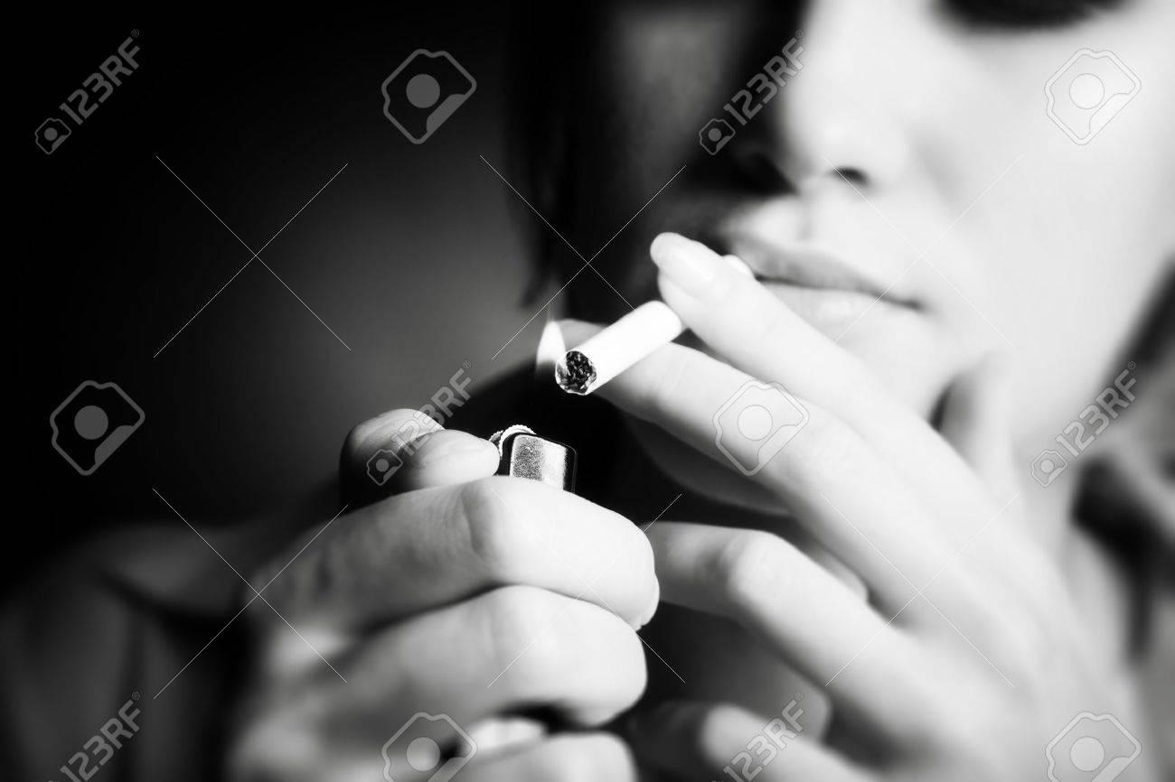 Smoking woman. Focus on cigarette lighter. Stock Photo - 5104417