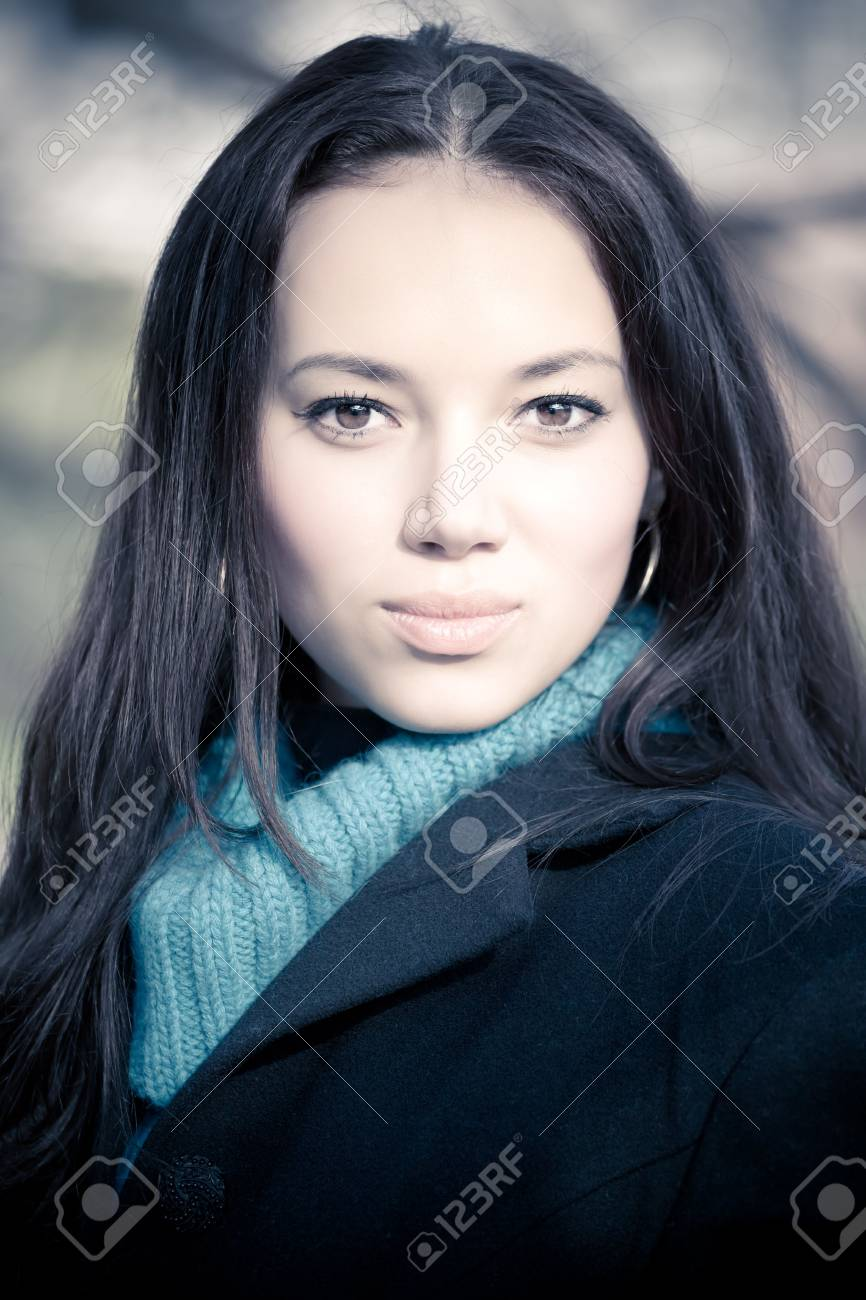 Young brunette woman outdoors portrait. Soft yellow and blue tint. Stock Photo - 5159256