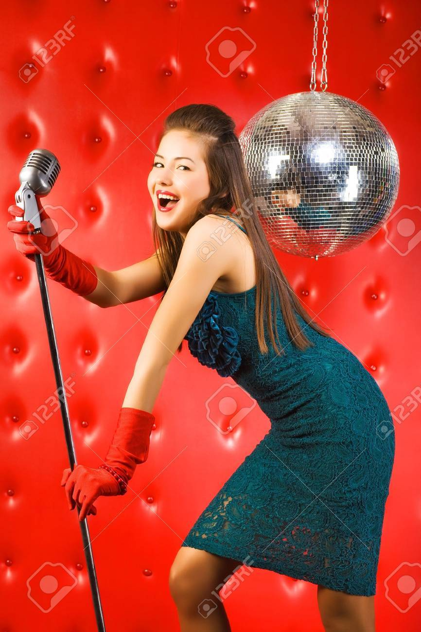 Young woman singer. Retro style. Stock Photo - 5265297