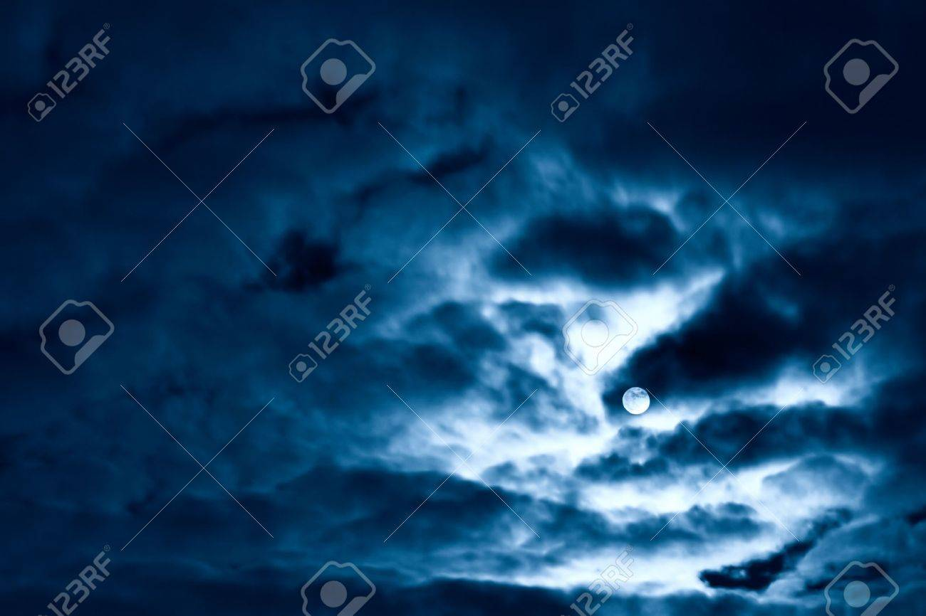 Night moon and clouds. Blue tint. Stock Photo - 5324503