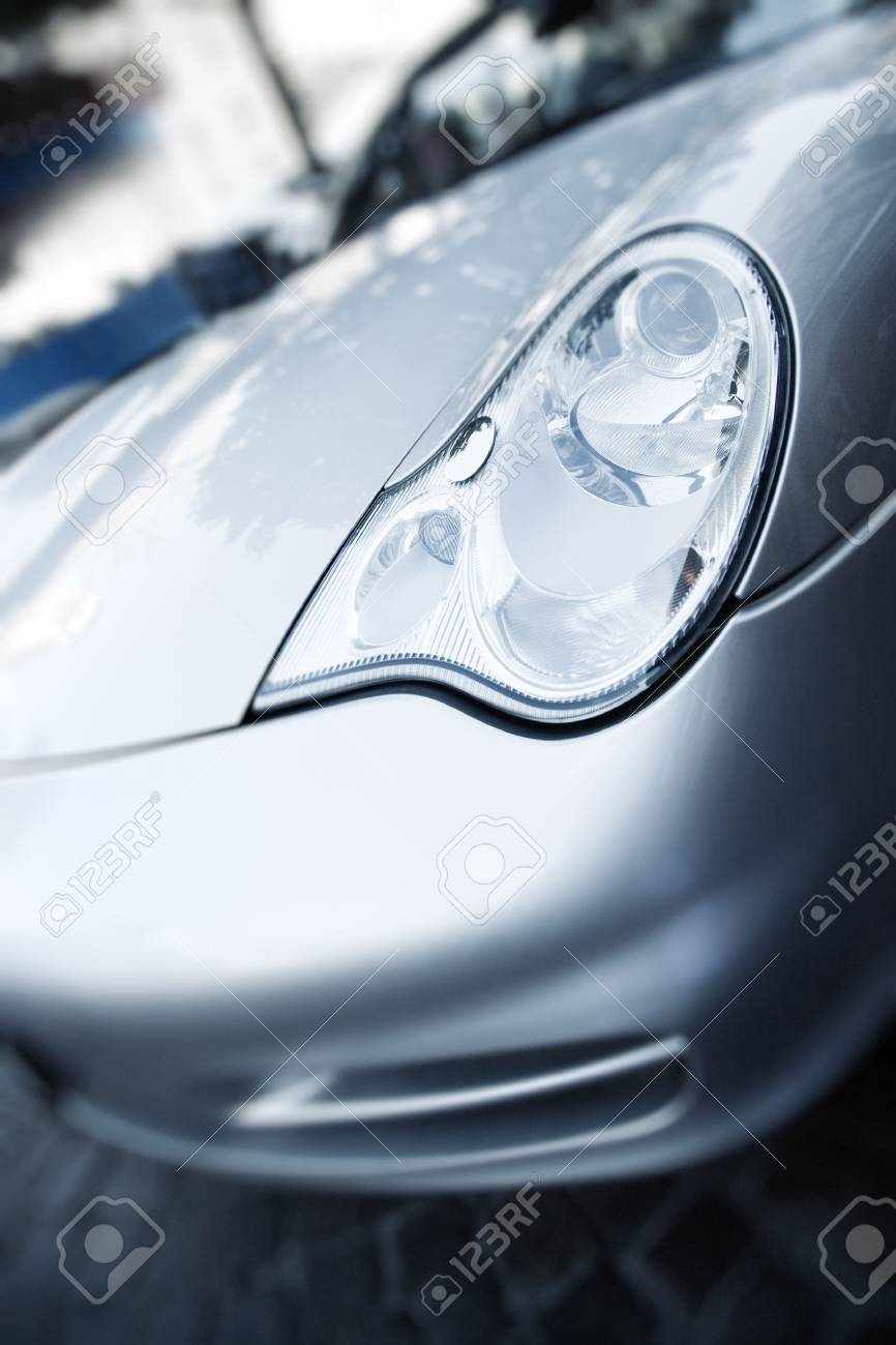 Modern sport car hood. Focus on headlight. Stock Photo - 6474730