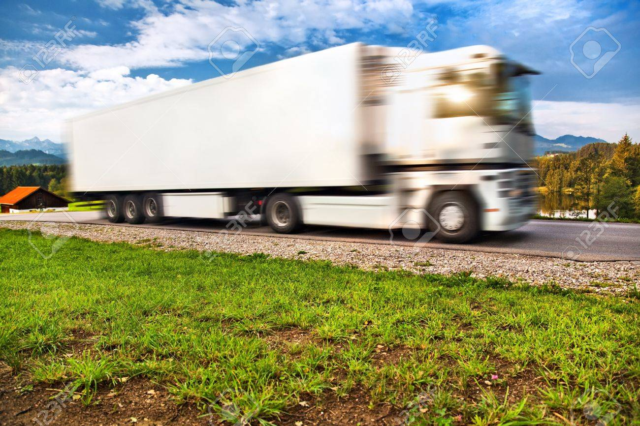 Truck transportation. Wide angle view and blurred motion effect. Stock Photo - 7030529