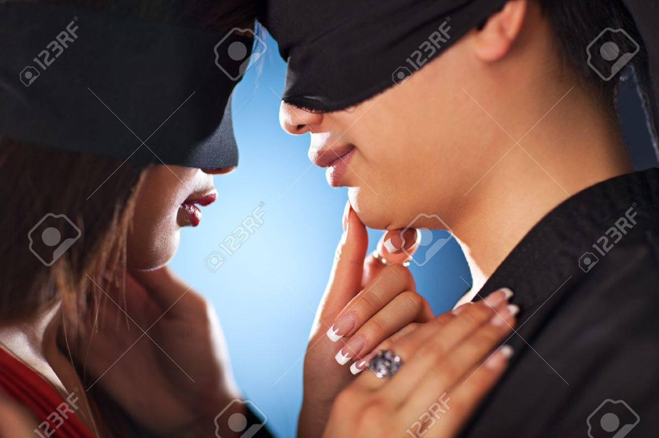Young japan couple with bandage on eyes in love. Stock Photo - 7149307