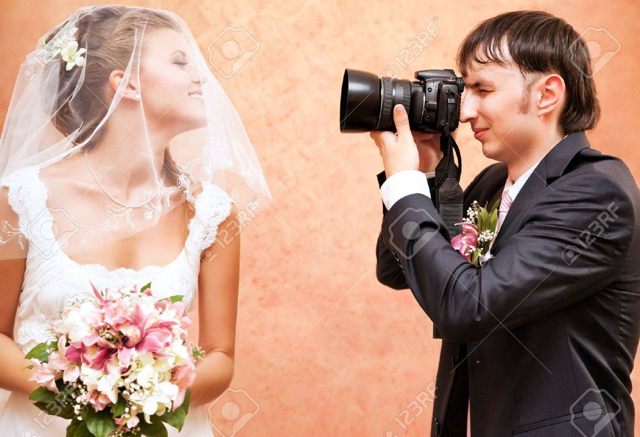 Husband taking picture of his wife on wedding. Stock Photo - 7487431