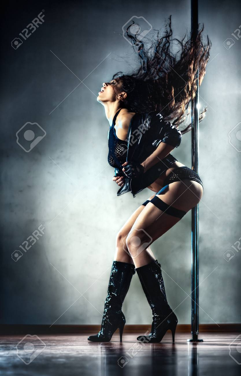 Young sexy pole dance woman. Stock Photo - 7878201