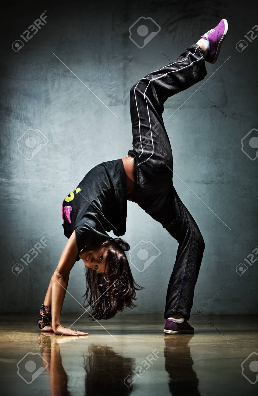 Young woman dancer. On wall background. Stock Photo - 7967852