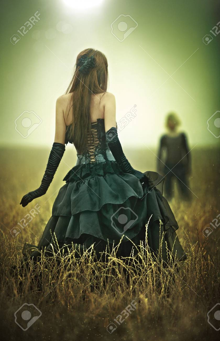 Young goth couple concept. Yellow and green tint. Stock Photo - 8016876