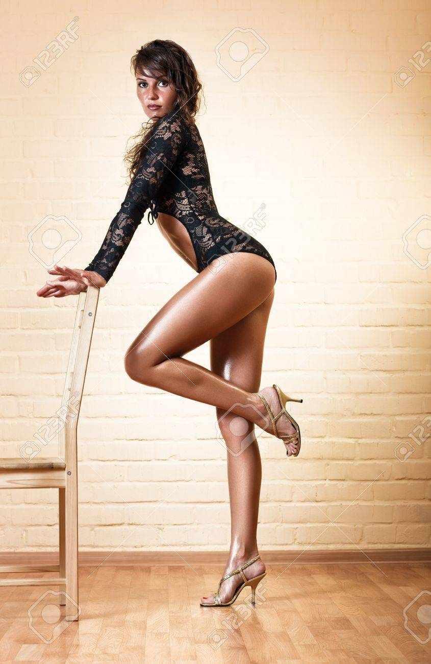 Young sexy woman with chair. Stock Photo - 8131440