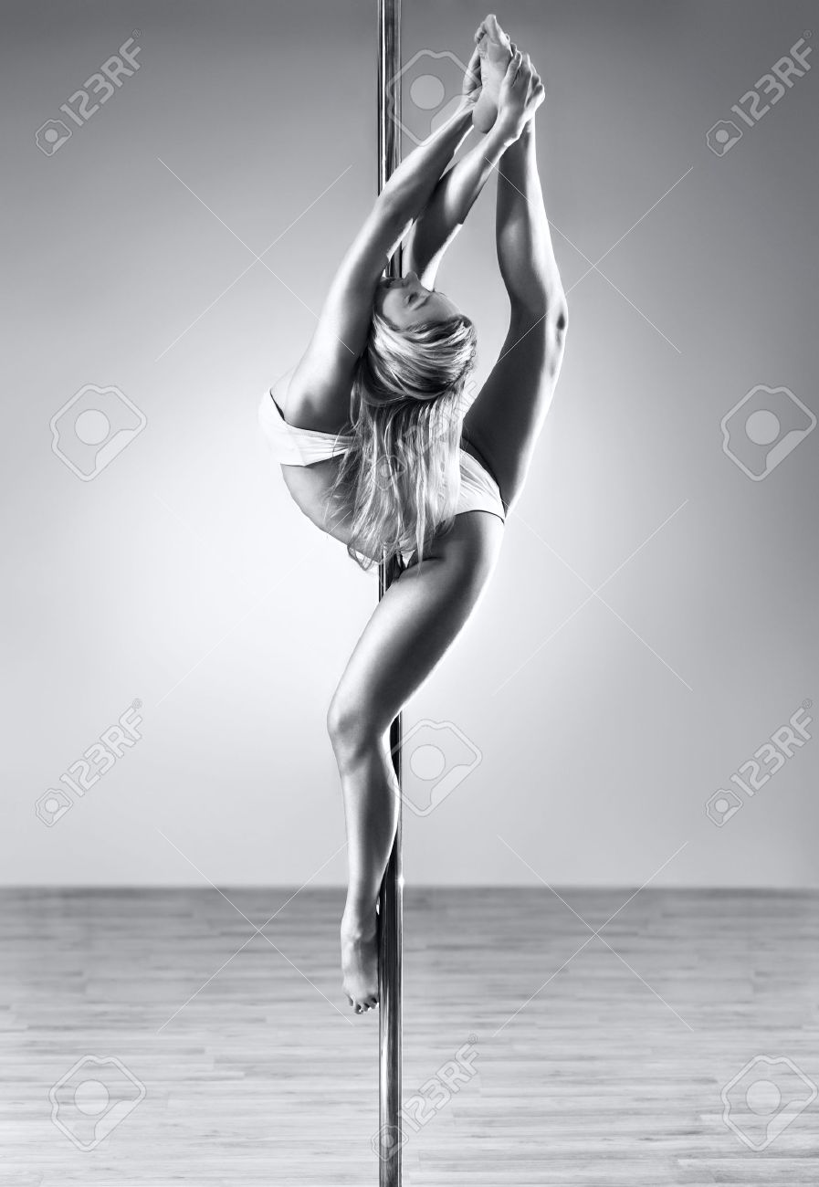 Young sexy pole dance woman. Black and white colors. Stock Photo - 8440194