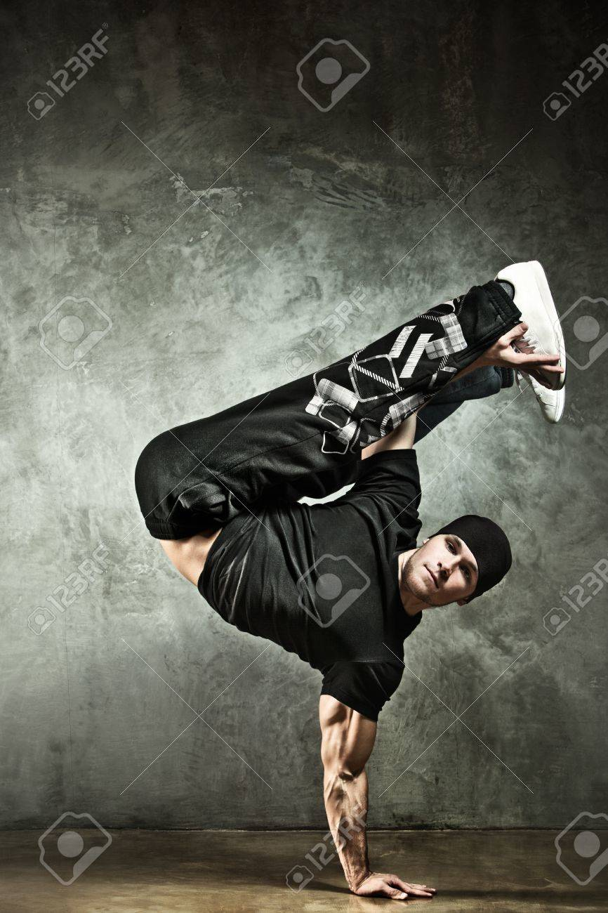 Young strong man break dance. On wall background. Stock Photo - 9305732