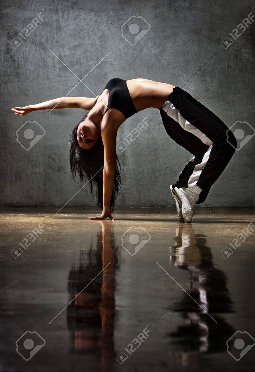 Young woman dancer. On wall background. Stock Photo - 9353589