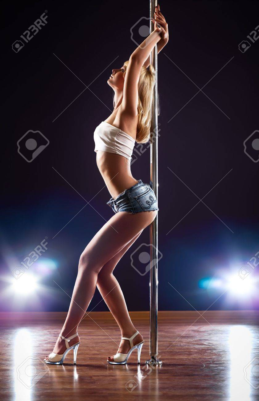 Young sexy pole dance woman. Stock Photo - 10117247